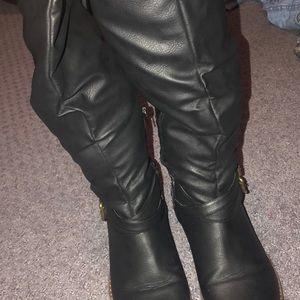 Black boots worn